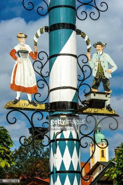 maypole, detail, schaefflertanz motif, parish church of the assumption behind, miesbach, upper bavaria, bavaria, germany - maypole stock pictures, royalty-free photos & images