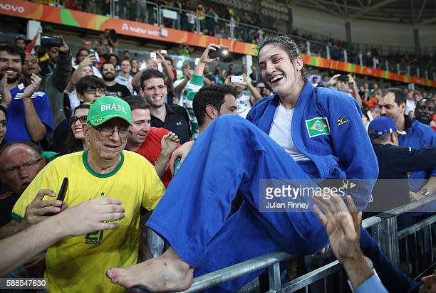Mayra Aguiar of Brazil celebrates after defeating Yalennis Castillo of Cuba during the women's 78kg bronze medal judo contest on Day 6 of the 2016...