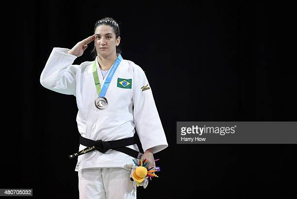 Mayra Aguiar of Brazil stands as a National Anthem is played after winning a silver medal in the minus 100kg judo during the 2015 Pan Am games at the...