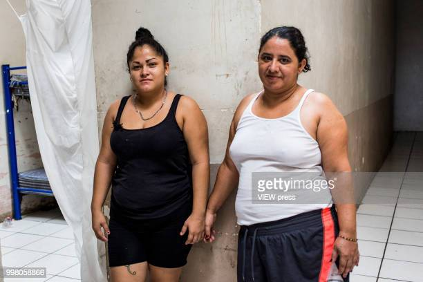 MEXICALI MEXICO July 10 Mayra Cepeda and Evelyn Lopez from Honduras pose for a portrait at Hotel del Migrante on July 10 2018 in Mexicali Mexico...