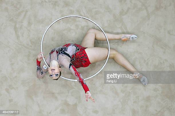 Mayra Tiago Sineriz of Brazil competes in the Individual AllAround Qualification on day ten of the Nanjing 2014 Summer Youth Olympic Games at Nanjing...