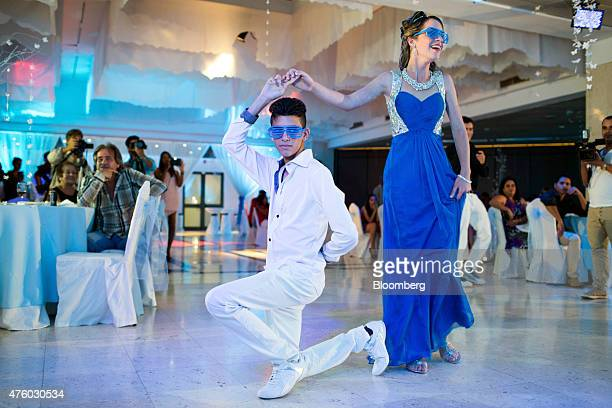 Mayralis Jimenez right dances with a friend at her quinceanera celebration at the Melia Cohiba hotel in Havana Cuba on Saturday March 28 2015 The...