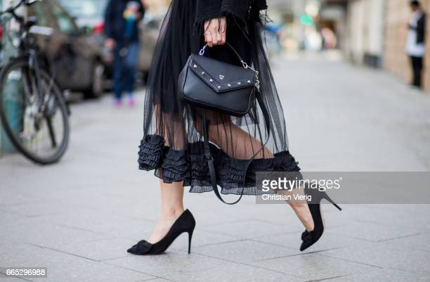 Mayrlou Becker wearing a white tshirt and black jacket Zara black sheer skirt Twist x Turn MCM bag vintage sunglasses heels on April 4 2017 in Berlin...