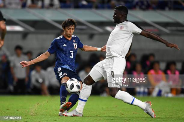 Mayron George of Costa Rica and Sei Muroya of Japan compete for the ball during the international friendly match between Japan and Costa Rica at...