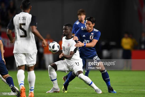 Mayron George of Costa Rica and Tomoaki Makino of Japan compete for the ball during the international friendly match between Japan and Costa Rica at...