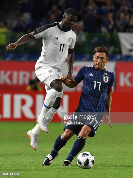 Mayron George of Costa Rica and Toshihiro Aoyama of Japan compete for the ball during the international friendly match between Japan and Costa Rica...