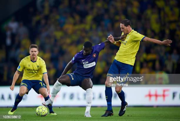Mayron George of FC Midtjylland and Benedikt Rocker of Brondby IF compete for the ball during the Danish Superliga match between Brondby IF and FC...