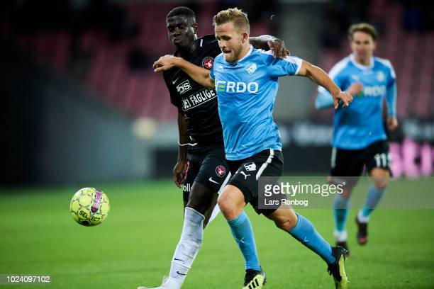 Mayron George of FC Midtjylland and Jonas Bager of Randers FC compete for the ball during the Danish Superliga match between FC Midtjylland and...