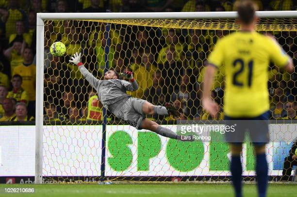 Mayron George of FC Midtjylland scores the 11 goal against Goalkeeper Marvin Schwabe of Brondby IF during the Danish Superliga match between Brondby...