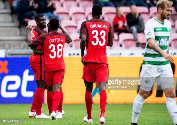 Mayron George of FC Midtjylland scoring the first goal and celebrating with Frank Onyeka of FC Midtjylland and Paul Onuachu of FC Midtjylland in the...