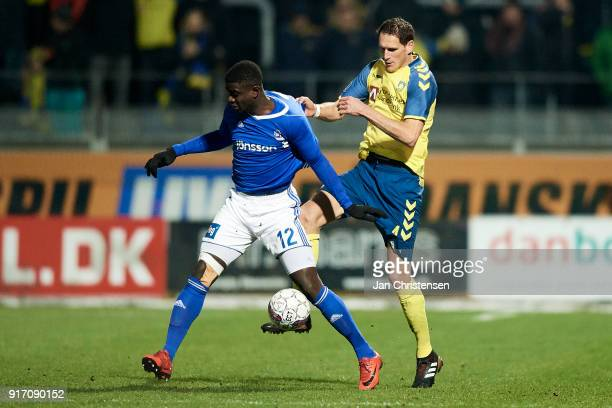 Mayron George of Lyngby BK and Benedikt Röcker of Brondby IF compete for the ball during the Danish Alka Superliga match between Lyngby BK and...