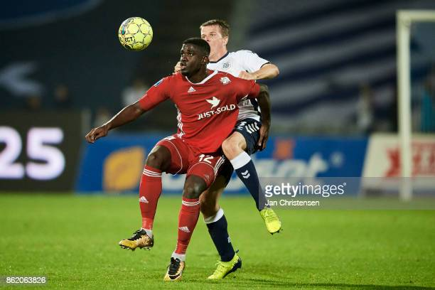 Mayron George of Lyngby BK and Jesper Juelsgard of AGF Arhus compete for the ball during the Danish Alka Superliga match between AGF Arhus and Lyngby...