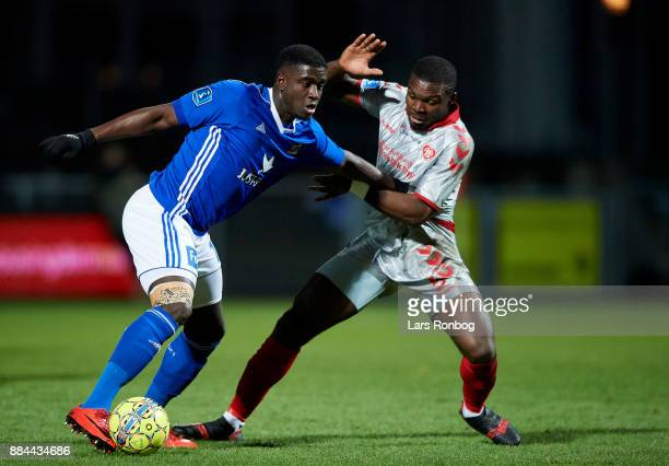 Mayron George of Lyngby BK and Jores Okore of AaB Aalborg compete for the ball during the Danish Alka Superliga match between Lyngby BK and AaB...