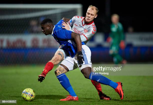 Mayron George of Lyngby BK and Kasper Pedersen of AaB Aalborg compete for the ball during the Danish Alka Superliga match between Lyngby BK and AaB...