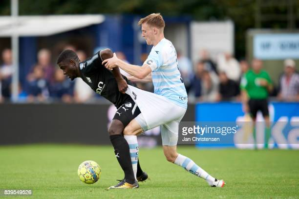 Mayron George of Randers FC and Andreas Holm of FC Helsingor compete for the ball during the Danish Alka Superliga match between FC Helsingor and...