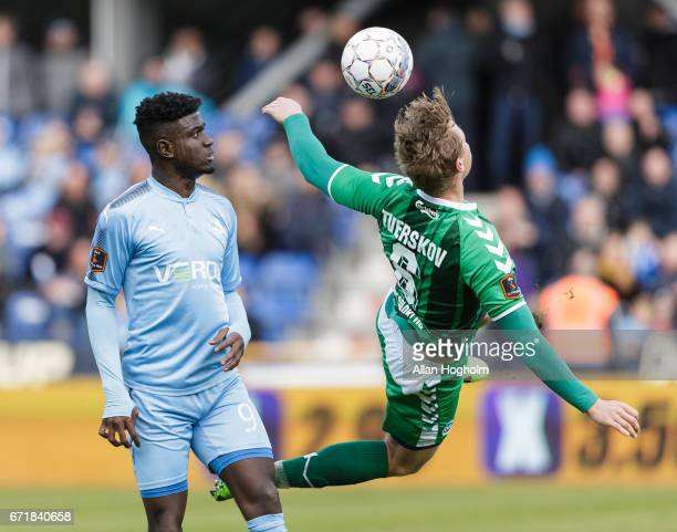 Mayron George of Randers FC and Jeppe Tverskov of OB compete for the ball during the Danish Alka Superliga match between Randers FC and OB Odense at...