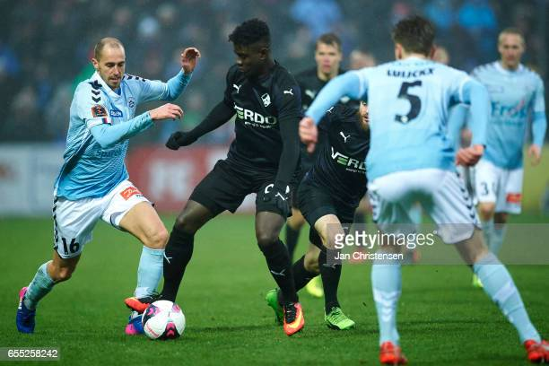 Mayron George of Randers FC compete for the ball during the Danish Alka Superliga match between SonderjyskE and Randers FC at Sydbank Park on March...