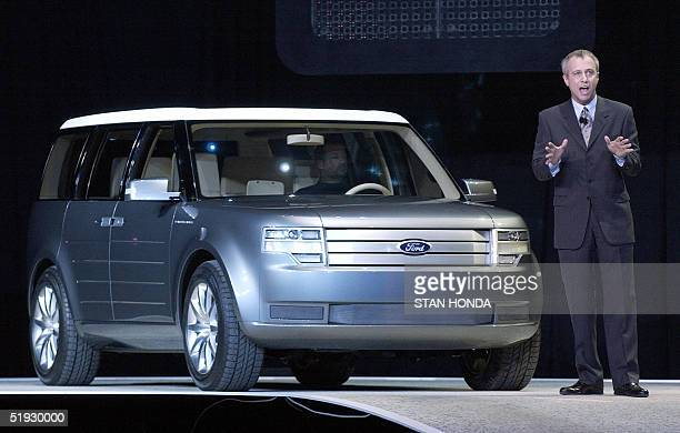Mays Ford group vice president of design and chief creative officer stands next to the Ford Fairlane concept car 09 January 2005 during the North...