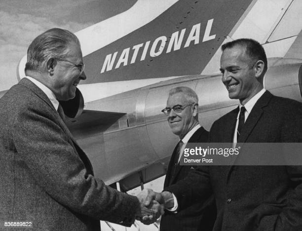 B Maytag Jr Right Makes a Stop in Denver Tuesday He shakes hands with Bill McNichols Denver manager of pubic works In center is Don Martin Denver...