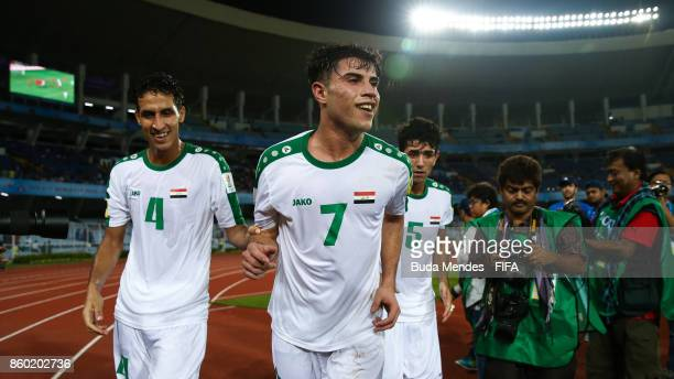 Maytham Jabbar Mohammed Dawood Muntadher Abdulsada of Iraq celebrate a scored goal during the FIFA U17 World Cup India 2017 group F match between...