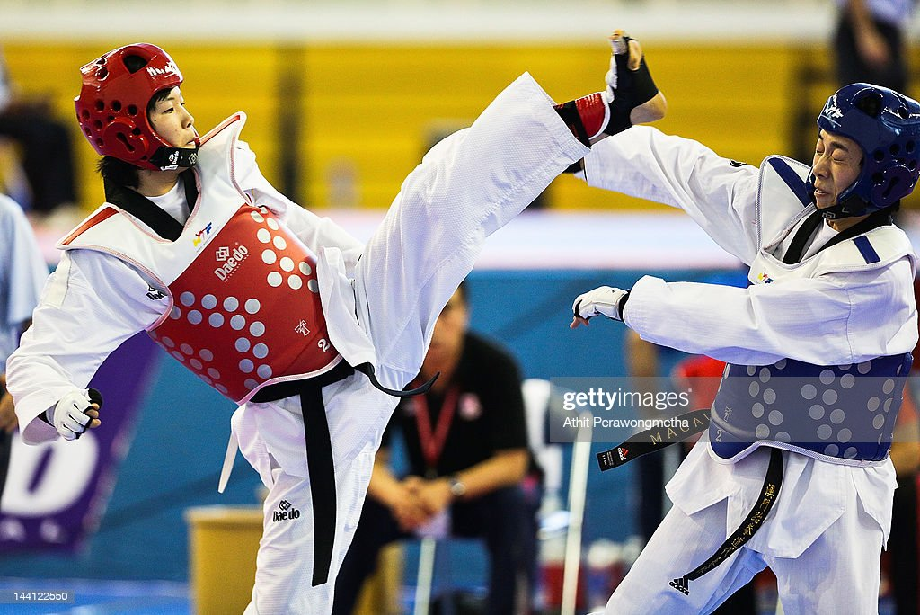 Mayu Hamada of Japan in action against Feng Xiao of Macao during day two of the 20th Asian Taekwondo Championships at Phu Tho Stadium on May 10, 2012 in Ho Chi Minh City, Vietnam.
