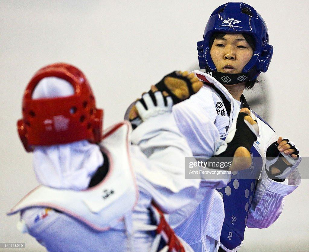 Mayu Hamada of Japan in action against Raheleh Asemani of Iran during day two of the 20th Asian Taekwondo Championships at Phu Tho Stadium on May 10, 2012 in Ho Chi Minh City, Vietnam.