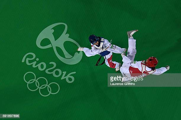 Mayu Hamada of Japan in action against Rahma Ben Ali of Tunisia during the Women's Taekwondo 57kg at the Carioca Arena on Day 13 of the 2016 Rio...
