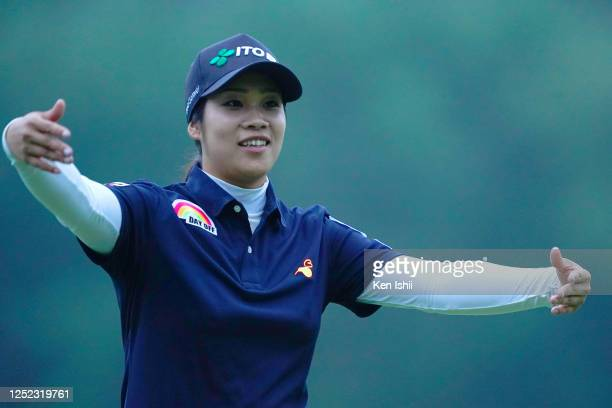 Mayu Hamada of Japan pretends to hug after holing out on the 9th green during the first round of the Earth Mondamin Cup at the Camellia Hills Country...