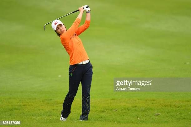 Mayu Hattori of Japan hits her second shot on the 13th hole during the first round of Stanley Ladies Golf Tournament at the Tomei Country Club on...