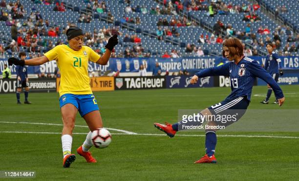 Mayu Ikejiri of Japan kicks into Monica of Brazil during the first half of the 2019 SheBelieves Cup match between Brazil and Japan Nissan Stadium on...