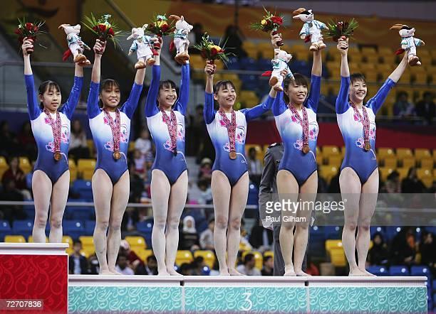 Mayu Kuroda Kyoko Oshima Miki Uemura Erika Mizoguchi Manami Ishizaka and Ayaka Sahara of Japan receive their Bronze Medals after the Women's Artistic...