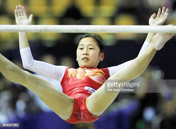 Mayu Kuroda of Japan competes in the Uneven Bars of the Women's Team Qualification during day four of the World Artistic Gymnastics Championships at...