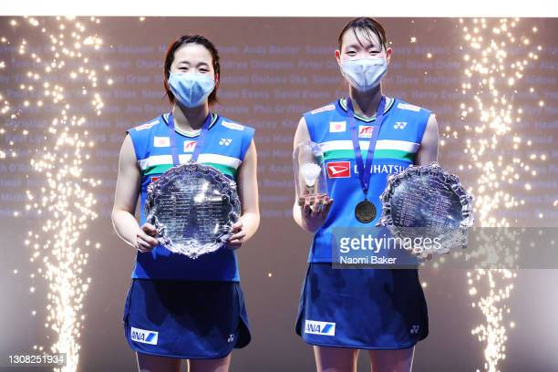 Mayu Matsumoto and Wakana Nagahara Japan pose with trophy after their victory in the Women's Double final during day five of YONEX All England Open...