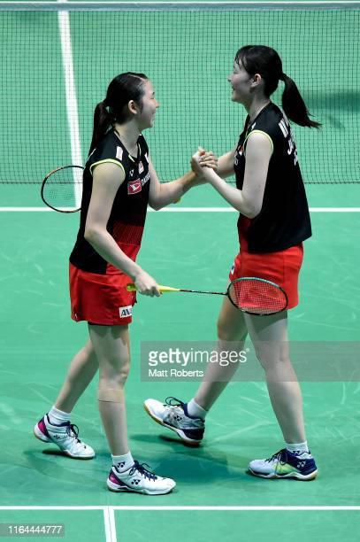 Mayu Matsumoto and Wakana Nagahara of Japan celebrate in the Women's Doubles semifinal match after defeating Misaki Matsutomo and Ayaka Takahashi of...