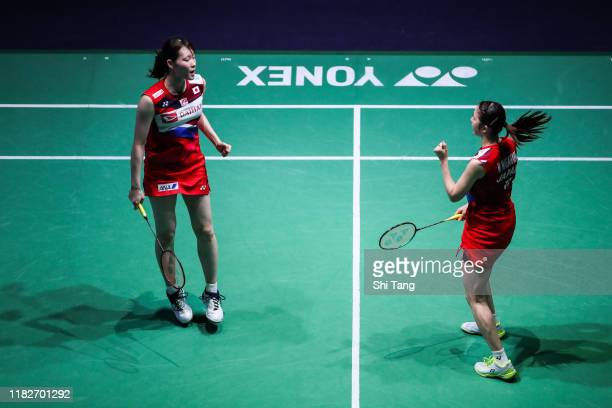 Mayu Matsumoto and Wakana Nagahara of Japan celebrate the victory in the Women's Doubles first round match against Chloe Birch and Lauren Smith of...