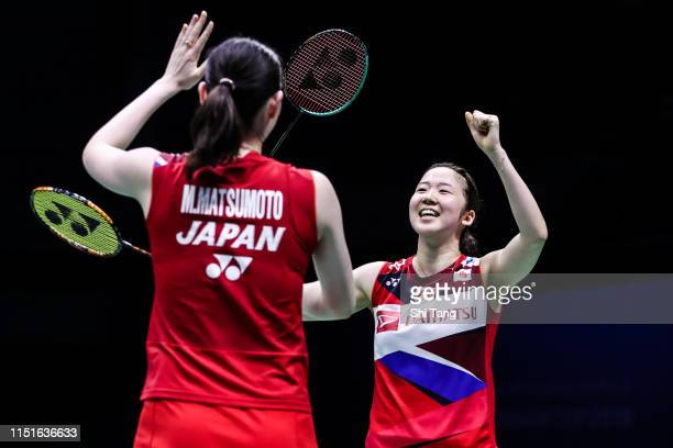 Mayu Matsumoto and Wakana Nagahara of Japan celebrate the victory after the Women's Doubles semi finals match against Greysia Polii and Apriyani...