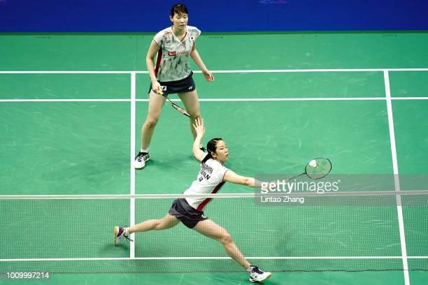 Mayu Matsumoto and Wakana Nagahara of Japan compete against Jongkolphan Kititharakul and Rawinda Prajongjai of Thailand in their Women's Doubles...