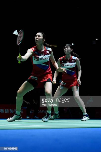 Mayu Matsumoto and Wakana Nagahara of Japan compete in the women's doubles match against Chow Mei Kuan and Lee Meng Yean of Malaysia on day three of...