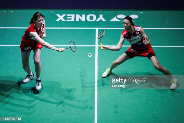 Mayu Matsumoto and Wakana Nagahara of Japan compete in the Women's Doubles first round match against Chloe Birch and Lauren Smith of England on day...