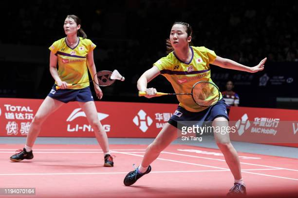Mayu Matsumoto and Wakana Nagahara of Japan compete in the Women's Double final match against Chen Qingchen and Jia Yifan of China during day five of...