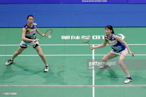 Mayu Matsumoto and Wakana Nagahara of Japan play a return against Jin Yujia and Lim Ming Hui of Singapore during their women's doubles second round...