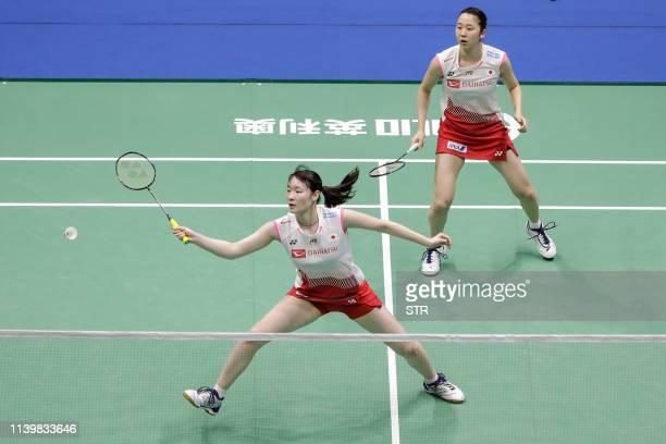 Mayu Matsumoto and Wakana Nagahara of Japan play a return against Chen Qingchen and Jia Yifan of China during the women's doubles final at the 2019...