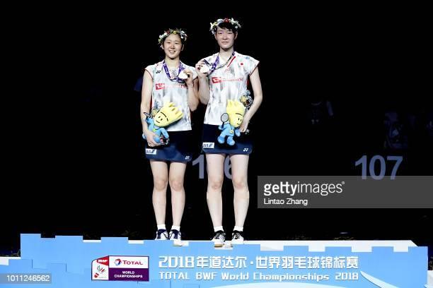 Mayu Matsumoto and Wakana Nagahara of Japan pose with their medals during the Women's Doubles awarding ceremony after defeating Yuki Fukushima and...