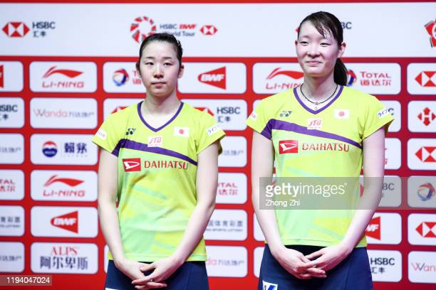 Mayu Matsumoto and Wakana Nagahara of Japan react during the award ceremony after winning over the women's doubles final match against Chen Qing Chen...