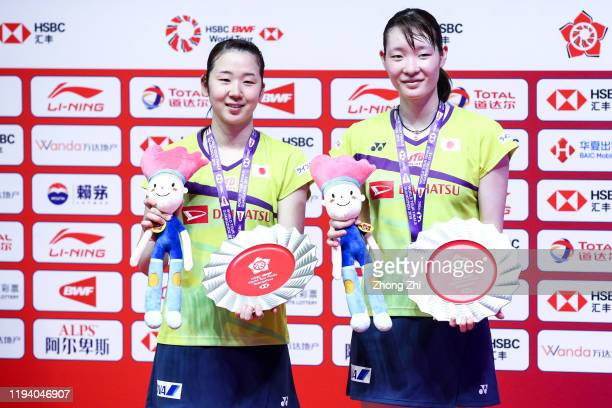 Mayu Matsumoto and Wakana Nagahara of Japan react with trophy during the award ceremony after winning over the women's doubles final match against...