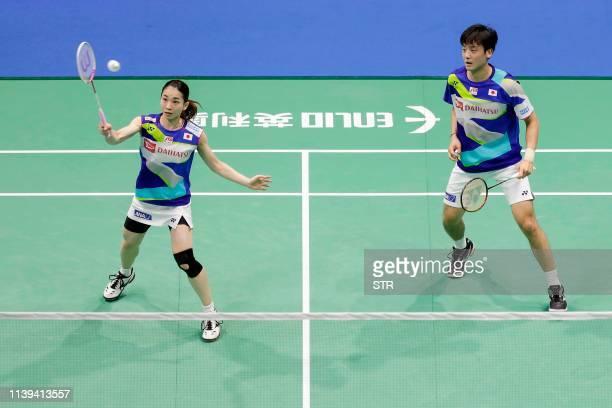 Mayu Matsumoto and Yuki Kaneko of Japan play a return against Zheng Siwei and Huang Yaqiong of China during their mix's doubles quarterfinal match at...
