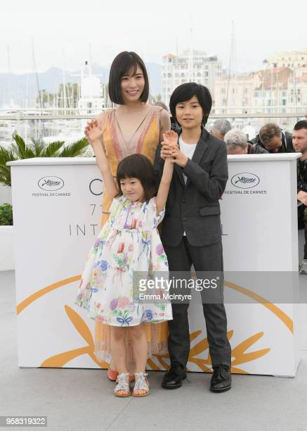 Mayu Matsuoka Miyu Sasaki and Jyo Kairi attend the photocall for Shoplifters during the 71st annual Cannes Film Festival at Palais des Festivals on...