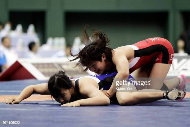 Mayu Mukaida competes against Saki Igarashi in the Women's 55kg final on day one of the All Japan Wrestling Invitational Championships at Komazawa...