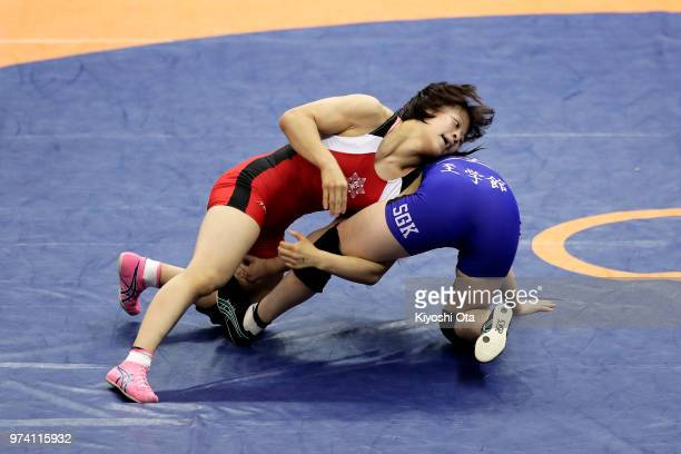 Mayu Mukaida competes against Tomoha Uchijo in the Women's 55kg second round match on day one of the All Japan Wrestling Invitational Championships...