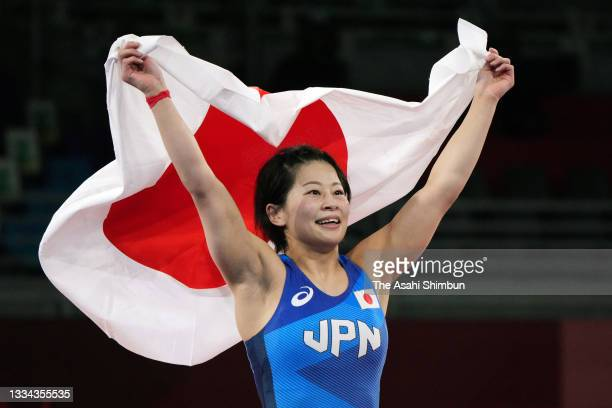 Mayu Mukaida of Team Japan celebrates winning the gold medal following her victory in the Women's Freestyle 53kg final against Pang Qianyu of Team...